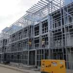 Light steel frame construction of four-storey apartment buildings at the 2011 All Africa Games Athletes' Village in Maputo, Mozambique