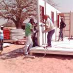 A Vela modular house going up in southern Angola.