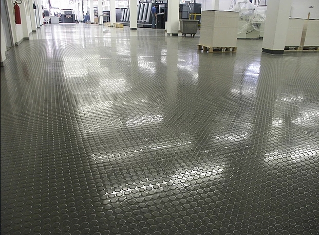 Ideal for heavy traffic and wear is the Transit 8x8 studded PVC floor tile