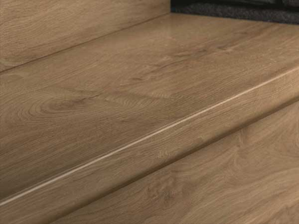 Wall bases and mouldings for laminate floors