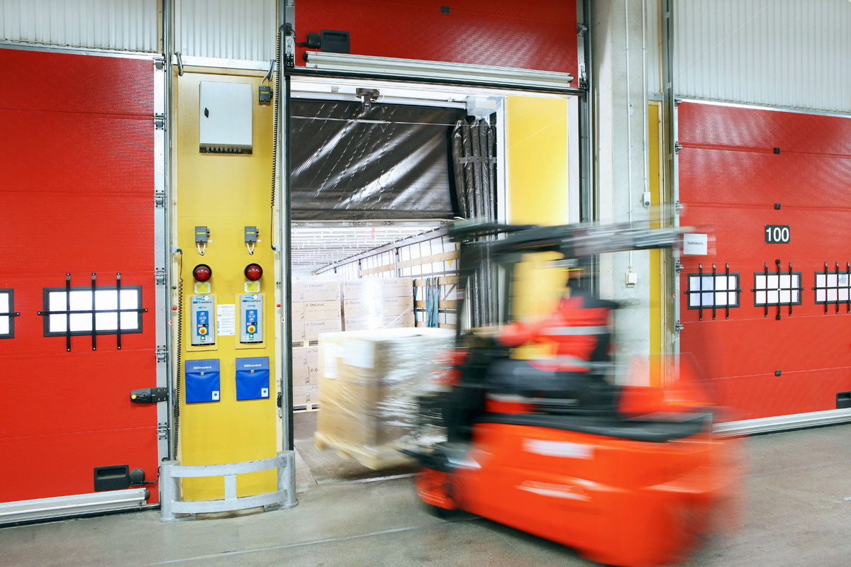 red sectional doors with forklift