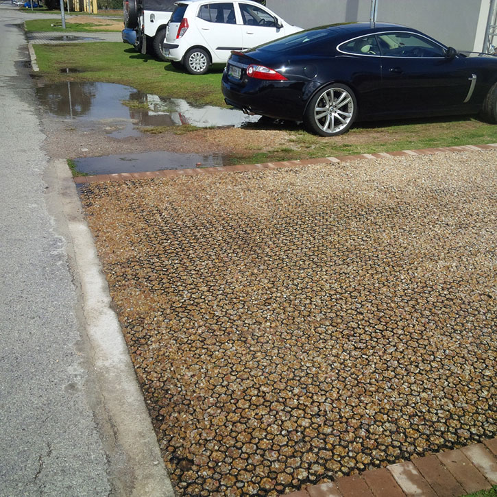 Rain drains away on the Sudpave laid area while it pools where there is no Sudpave