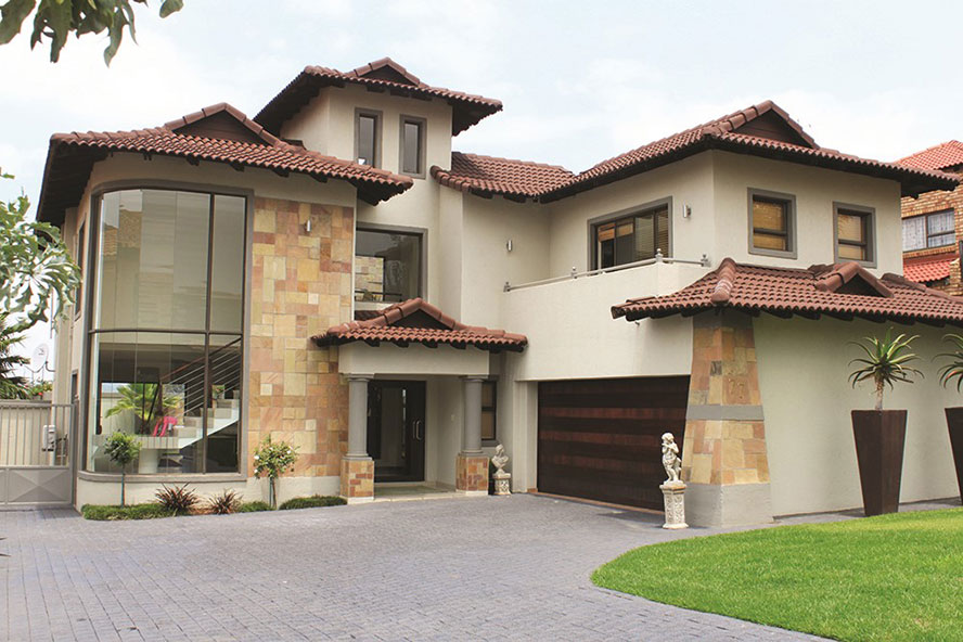 Sandstone cladding highlights exterior features in this house