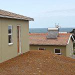 Precast concrete roof tiles