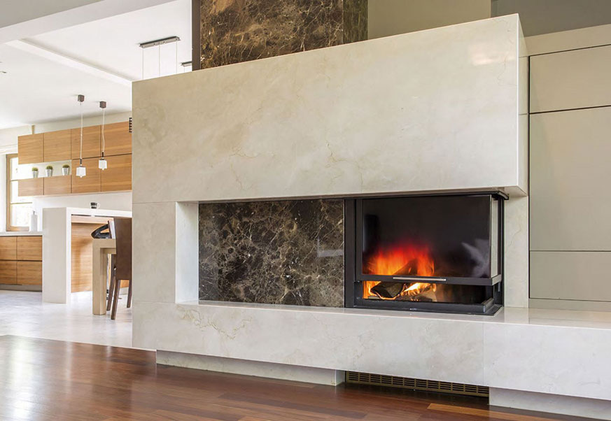 Fireplace cladded with Marron Emperador Dark and Crème Marfil Marble