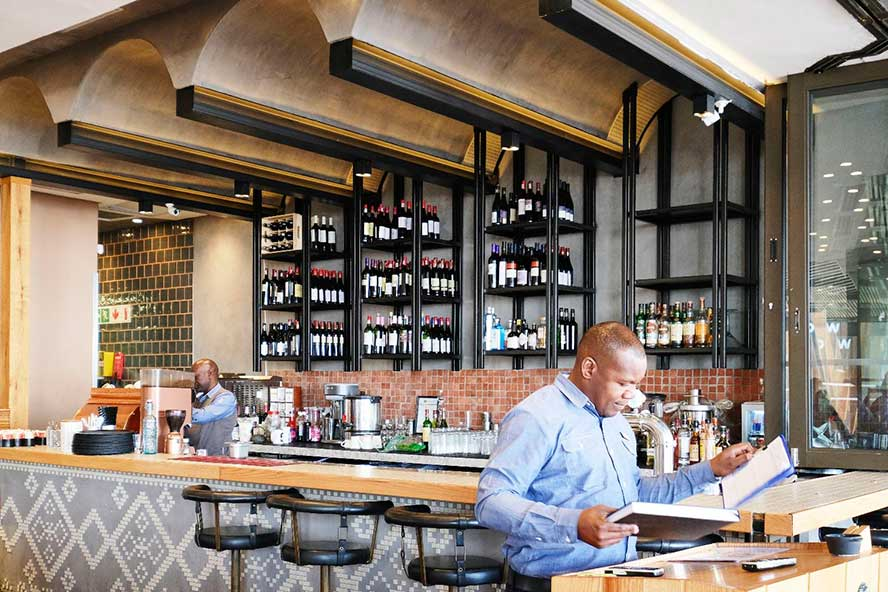 SatinCrete Dolphin Grey ceilings and bar front in the Rock Diner in Kyalami