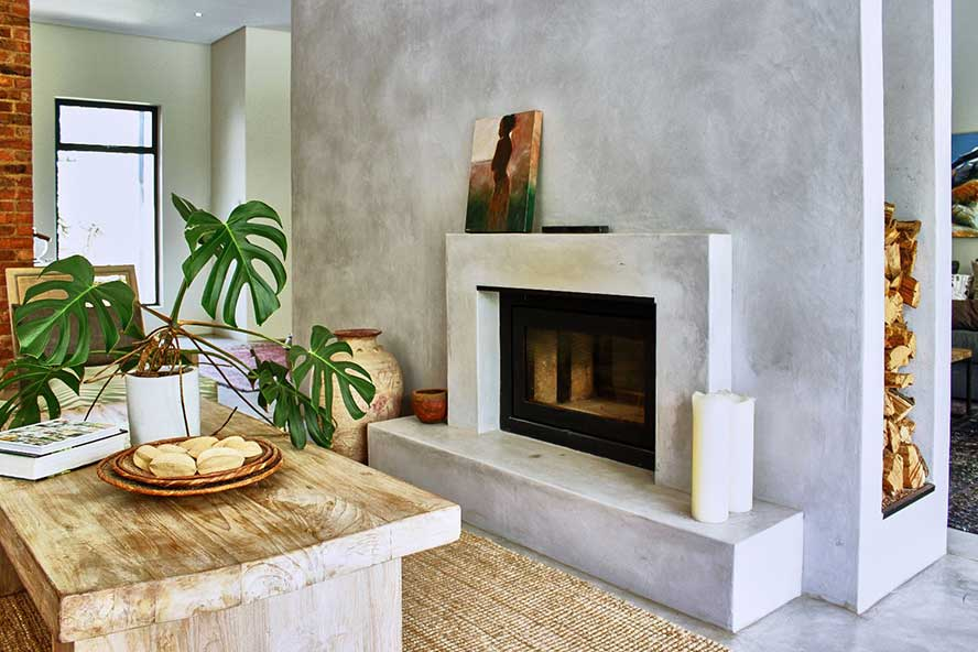 An organic home featuring SatinCrete Pewter feature wall and fireplace.