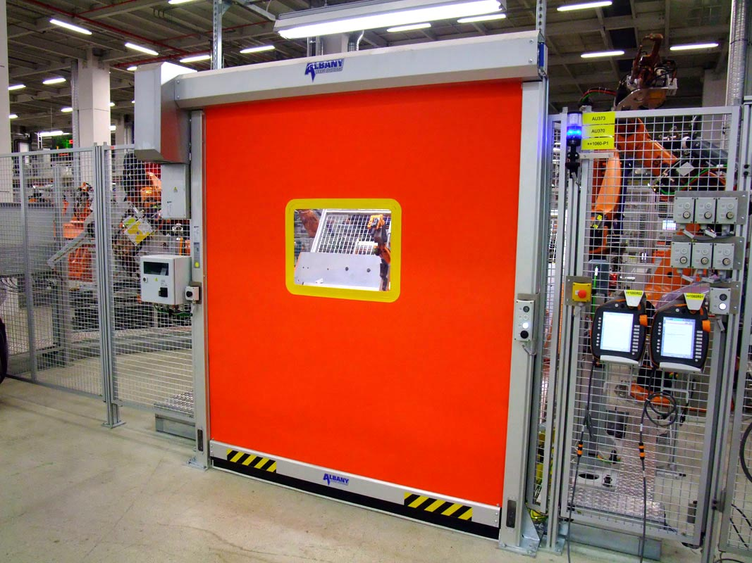 Machine protection doors for safer manufacturing