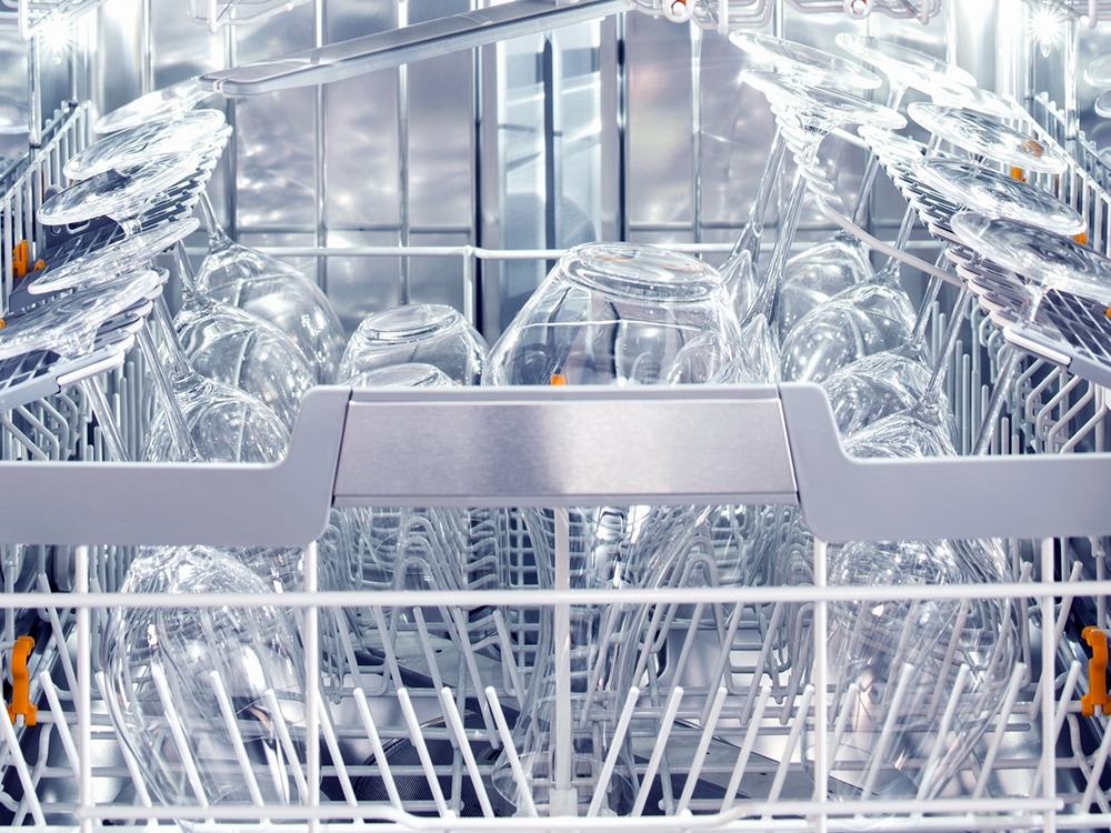 clean dishes and wine glasses in the miele smart dishwasher