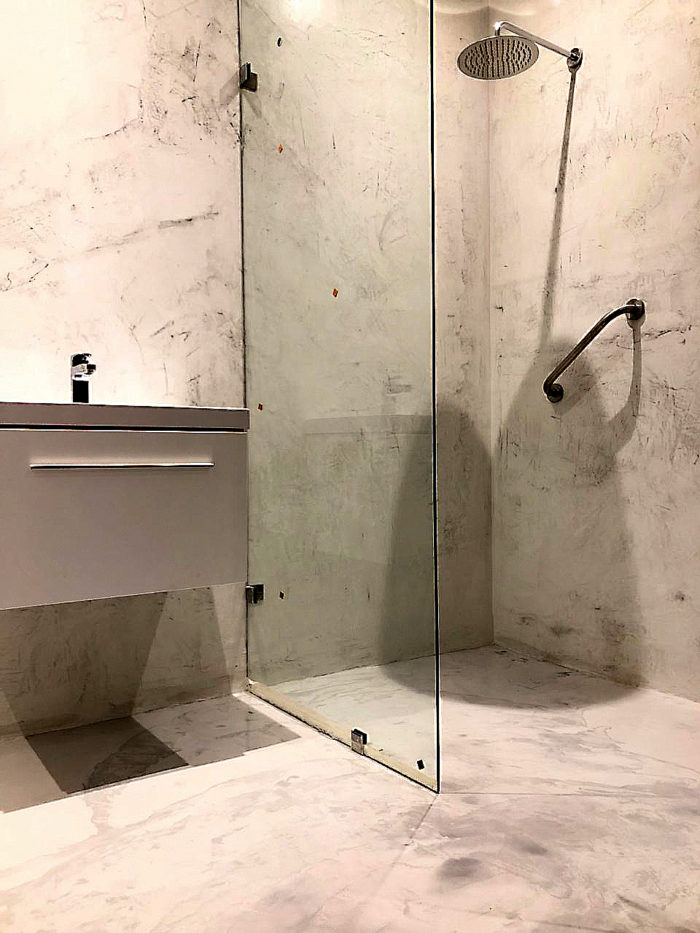 bathroom wall and floor finishes for concrete that looks like marble beton cire hotel bathroom