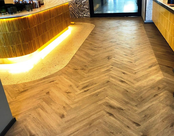 City Lodge flooring with Aspecta 1 (Glued Down) Herringbone